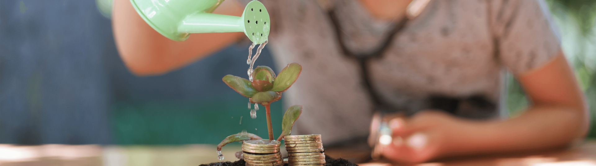 girl watering money plant